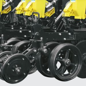 Wheels for depth control and compaction with manual adjustment. Parallel and angular depth control system.
